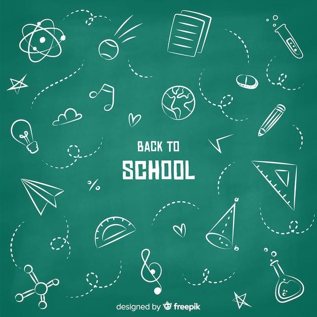 Disegnato a mano torna a scuola sfondo Vettore gratuito