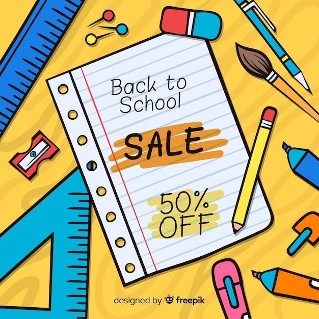 Disegnato a mano torna a sfondo delle vendite della scuola Vettore gratuito