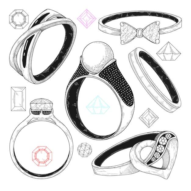 Disegnato a mano un set di diversi anelli di gioielli. Vettore Premium