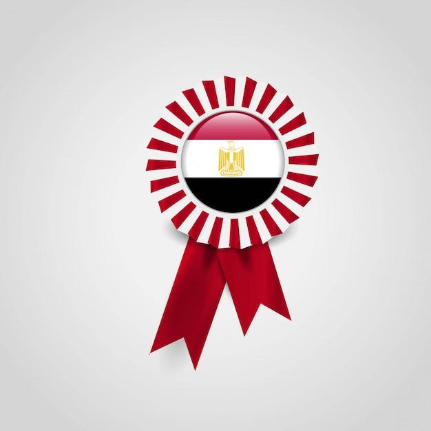 Distintivo dell'insegna del nastro della bandiera dell'egitto Vettore Premium