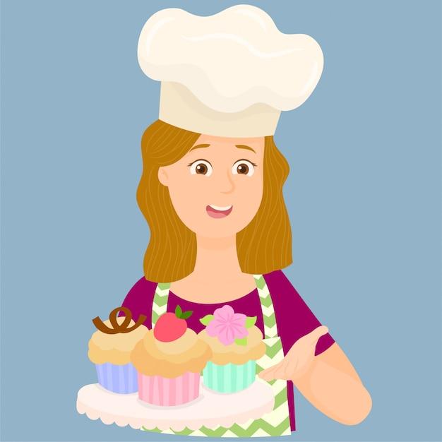 Donna che mostra alcuni dei suoi cupcakes appena sfornati Vettore Premium