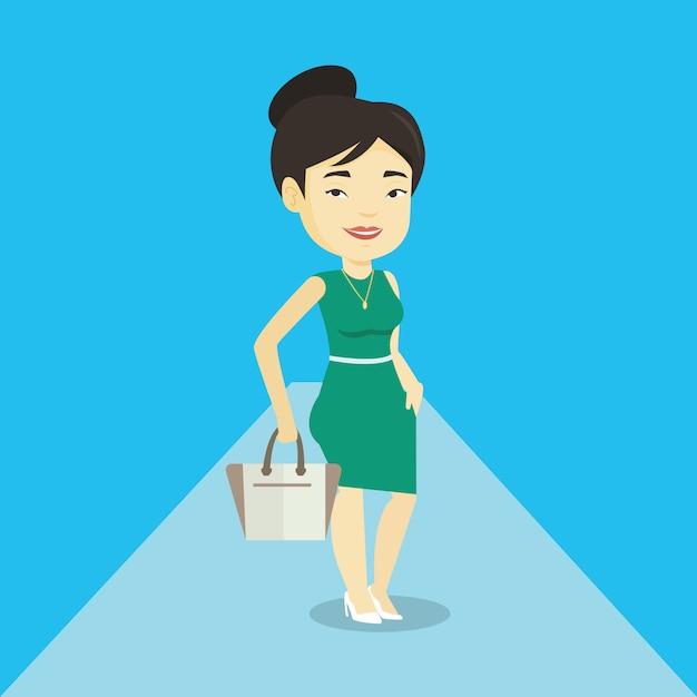 Donna che posa sulla passerella durante la sfilata di moda. Vettore Premium