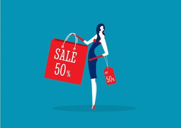 Donna che presenta il prodotto di sconto con le vendite Vettore Premium