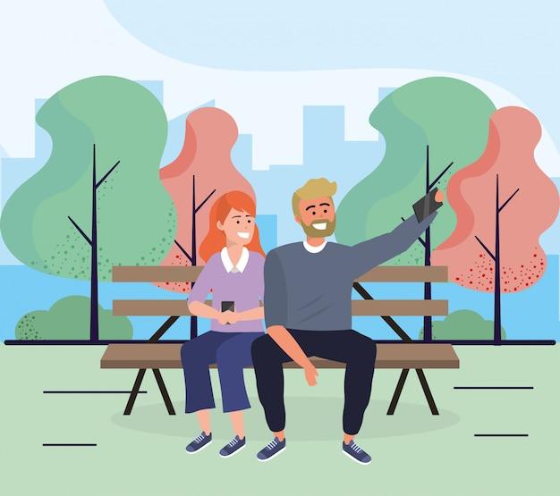 Donna e uomo seduto sulla sedia con lo smartphone Vettore Premium