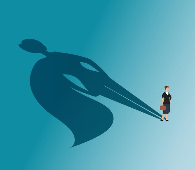 Donna esecutiva con l'ombra del supereroe. Vettore Premium