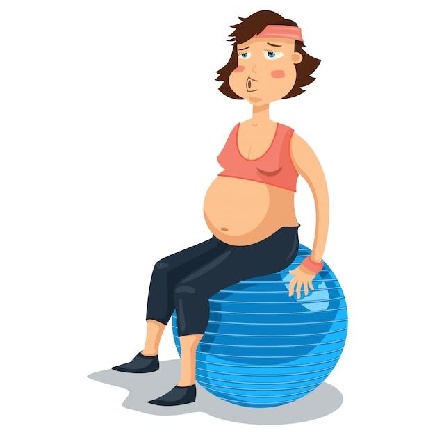 Donna incinta sulla palla ginnica Vettore Premium