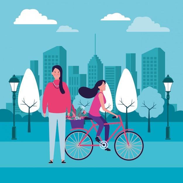 Donne in sella a bici con fiore Vettore Premium