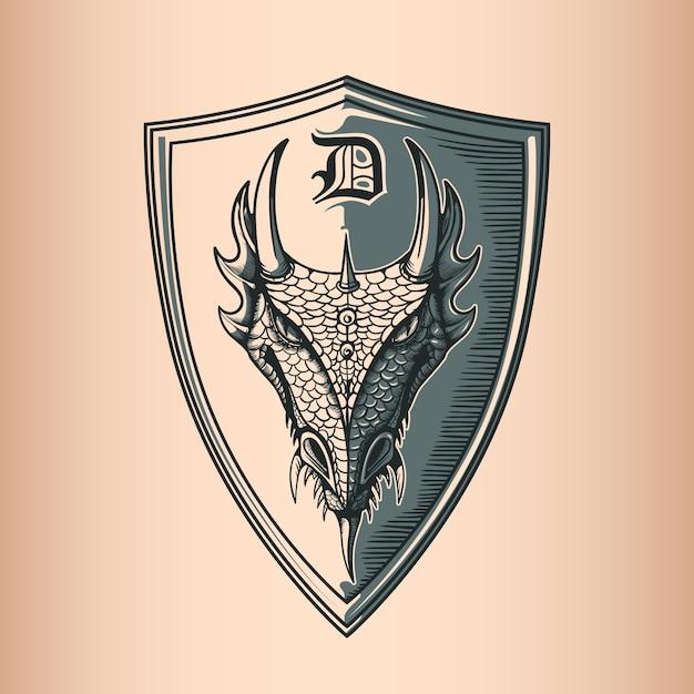 Dragon on shield. Vettore Premium