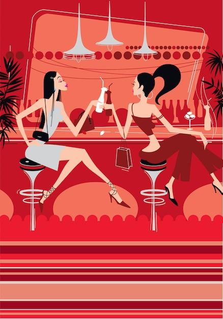 Due belle ragazze bevono cocktail in un locale notturno. Vettore Premium