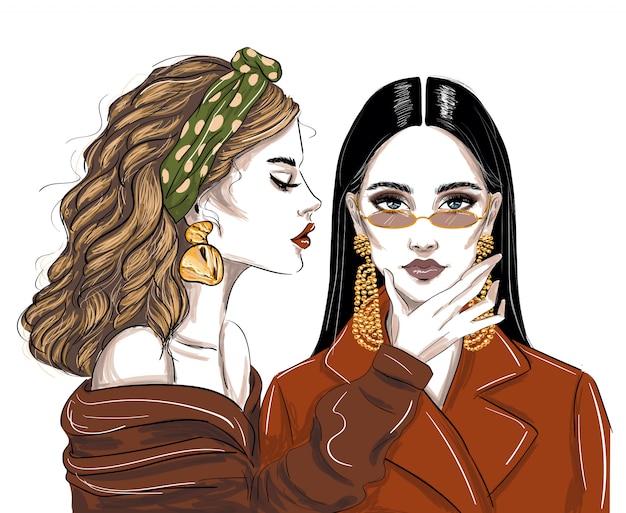 Due donne in accessori alla moda Vettore Premium
