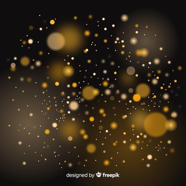 Effetto bokeh galleggiante di particelle dorate Vettore gratuito