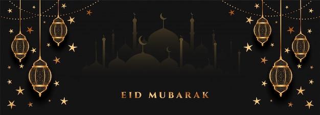Eid mubarak design del banner festival nero e oro Vettore gratuito