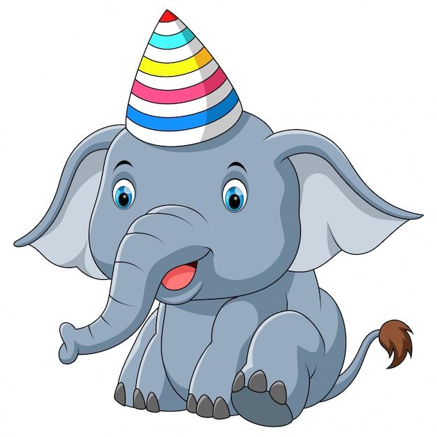 Elefante del bambino usando cartoon partito cappello Vettore Premium