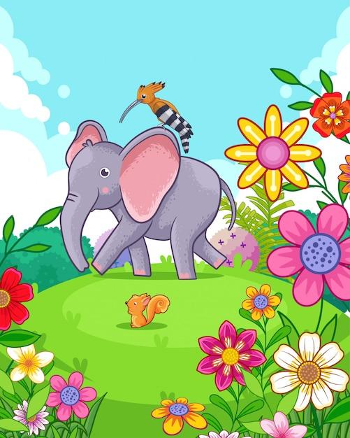 Elefante sveglio felice con i fiori che giocano nel giardino Vettore Premium