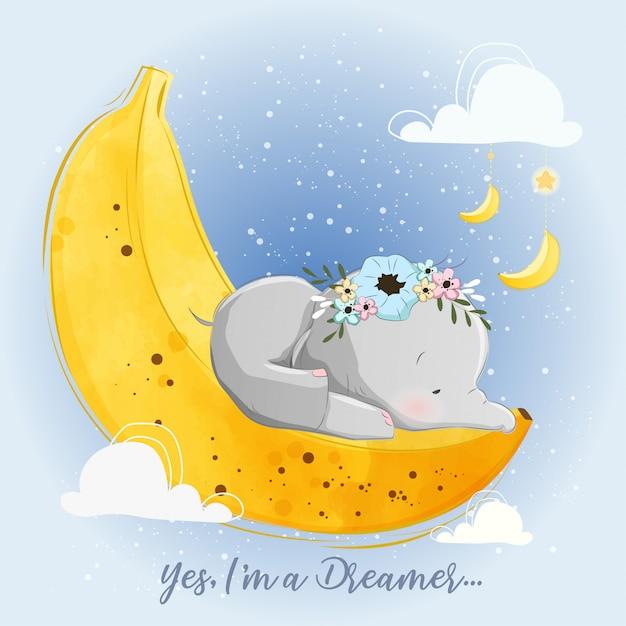 Elefantino che dorme su una luna di banana Vettore Premium