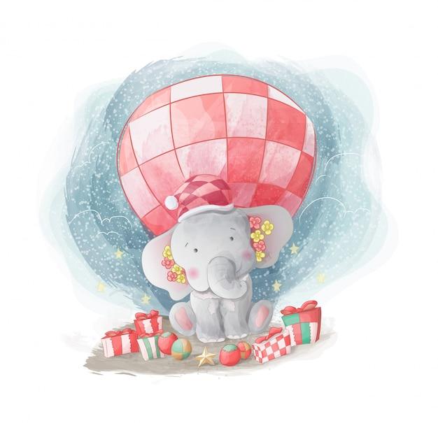 Elefantino felice di ottenere un regalo di natale Vettore Premium