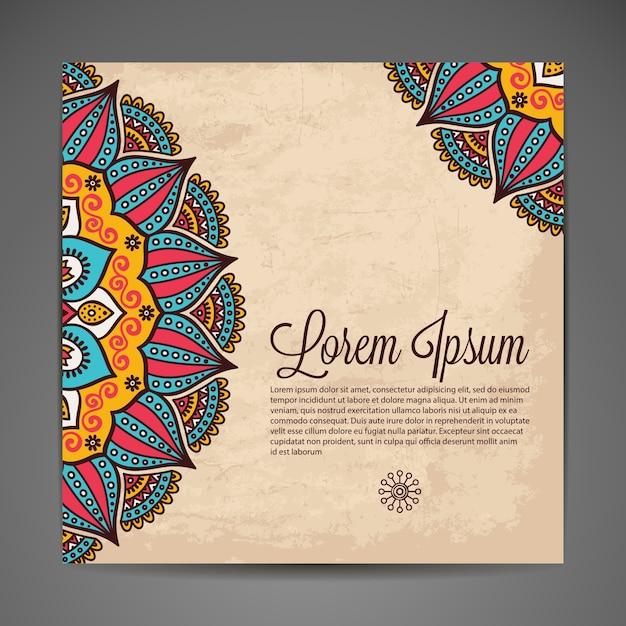 Elegante ornamento indiano su uno sfondo scuro Design elegante Può essere utilizzato come biglietto di auguri o invito a nozze Vettore gratuito