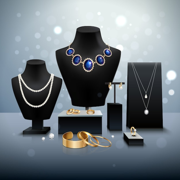 Esposizione di gioielli in oro e argento realistici su manichini e bancarelle nere su superficie grigia Vettore gratuito
