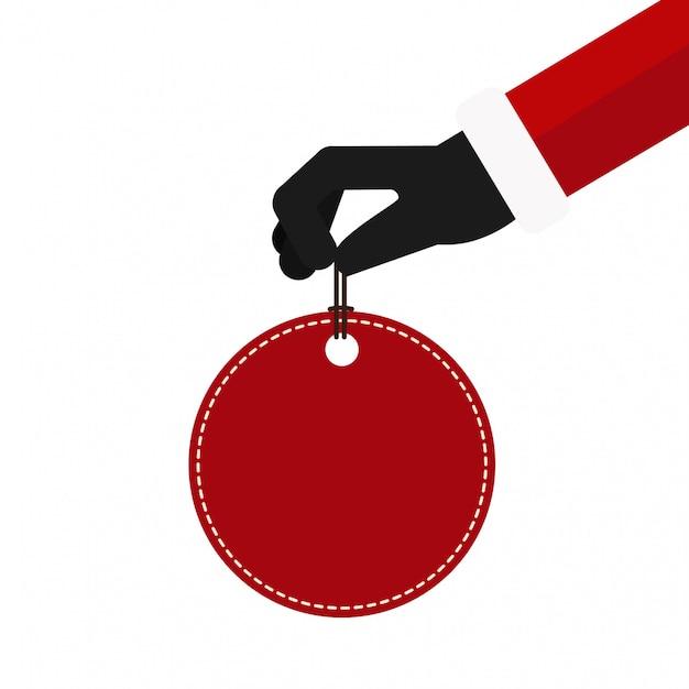 Etichetta rossa di prezzo della tenuta della mano del babbo natale di natale Vettore Premium