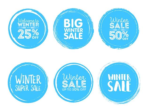 Etichette di saldi invernali Vettore Premium