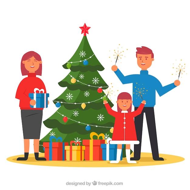 Regali Di Natale Famiglia.Famiglia Con Fuochi D Artificio E Regali Di Natale Scaricare