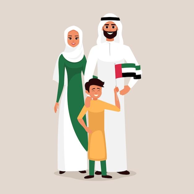 Famiglia felice che celebra la festa dell'indipendenza degli emirati arabi uniti Vettore Premium