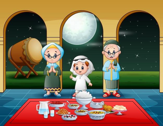 Famiglia musulmana che celebra l'iftar party Vettore Premium