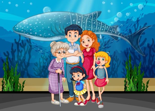 Famiglia nella scena o nel fondo dell'acquario Vettore gratuito