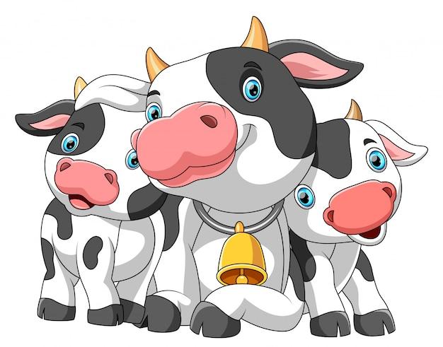 Famiglia simpatico cartone animato di mucca Vettore Premium