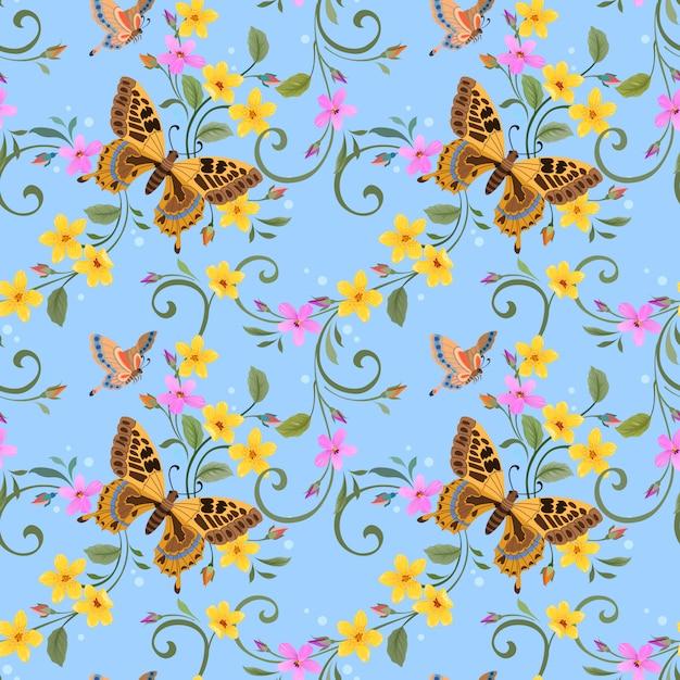 Farfalla e bellissimi fiori sul modello senza cuciture blu. Vettore Premium