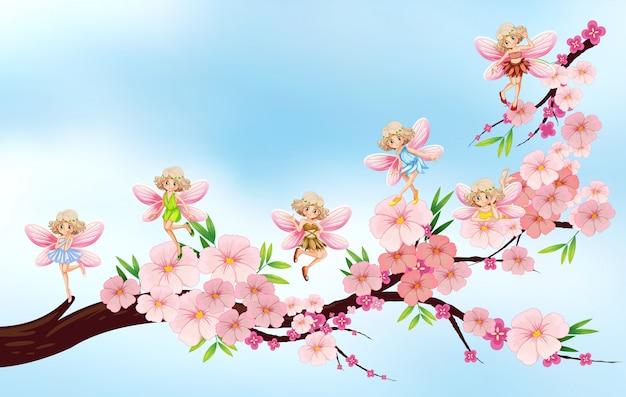 Fate volare sul ramo di fiori Vettore Premium