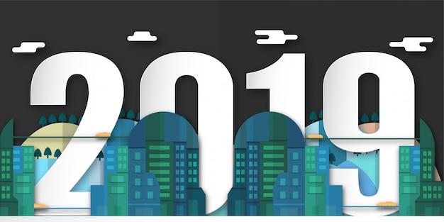 Felice anno nuovo 2019 decorazione di notte con la città urbana in carta tagliata e artigianato digitale. Vettore Premium