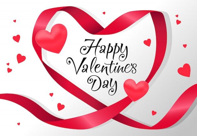 Felice giorno di san valentino lettering nel telaio del nastro a forma di cuore rosso Vettore gratuito