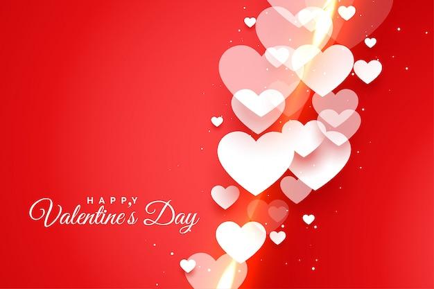 Felice giorno di san valentino rosso con carta di cuori bianchi Vettore gratuito