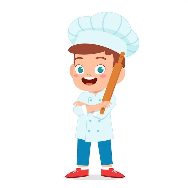 Felice ragazzo carino bambino in costume da chef Vettore Premium