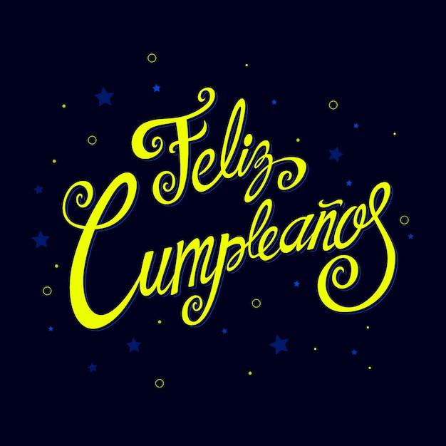 Feliz cumpleanos lettering con elementi festivi Vettore gratuito
