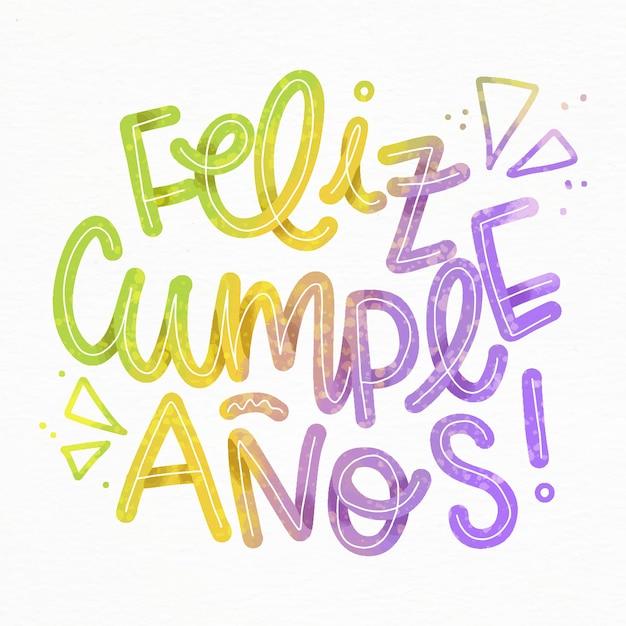 Feliz cumpleaños lettering con triangoli Vettore gratuito