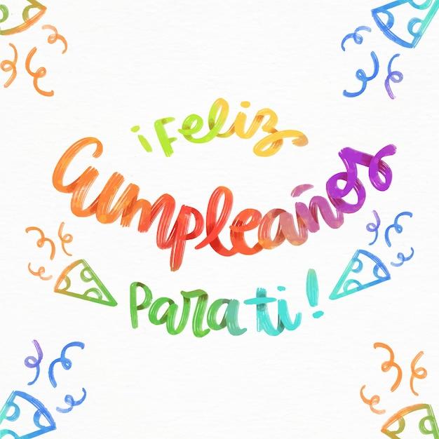 Feliz cumpleaños scritte con cappelli da festa Vettore gratuito