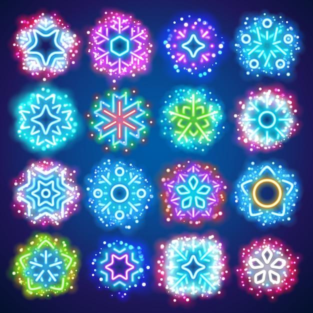 Fiocchi di neve al neon di natale con scintille magiche Vettore Premium