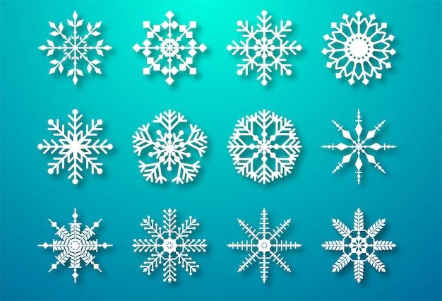 Fiocchi di neve di natale decorativi impostare elementi Vettore gratuito