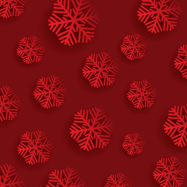 Fiocchi di neve su uno sfondo rosso Vettore gratuito