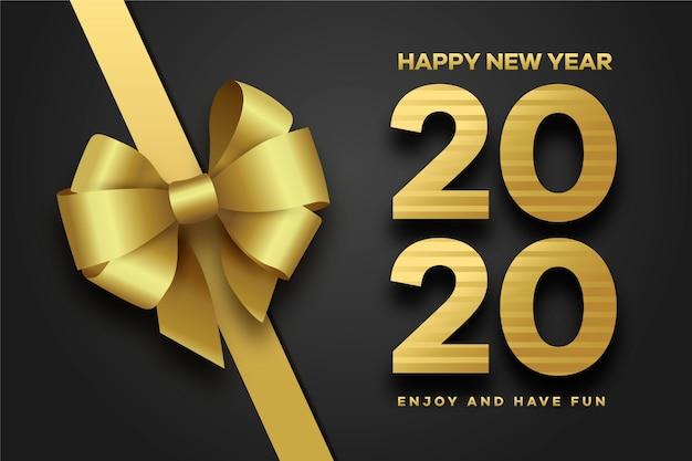 Fiocco regalo dorato per il nuovo anno 2020 Vettore gratuito