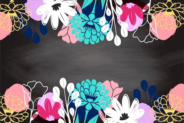 Fiori disegnati a mano sul fondo della lavagna Vettore gratuito