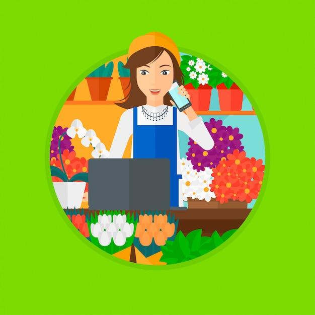 Fiorista al negozio di fiori. Vettore Premium