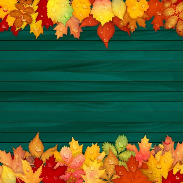 Foglie colorate su fondo in legno Vettore Premium