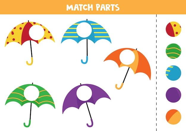 Foglio di lavoro educativo per bambini in età prescolare. abbina parti di ombrelli. Vettore Premium