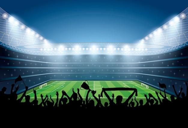 Folla entusiasta di persone in uno stadio di calcio. Vettore Premium