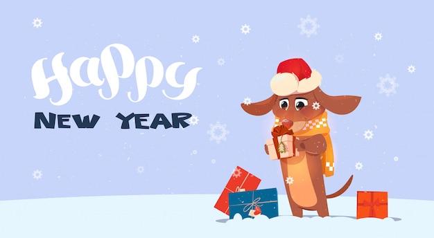Fondo del buon anno 2018 con il cane sveglio che porta il cappello di santa Vettore Premium
