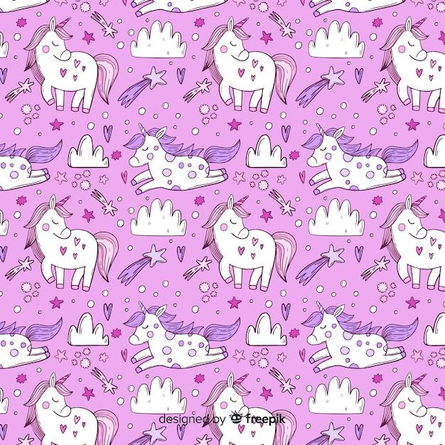 Fondo del modello di unicorno disegnato a mano Vettore gratuito