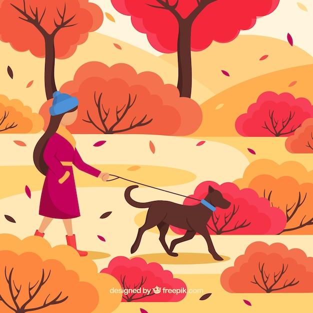Fondo di autunno con la donna che prende cane per una passeggiata Vettore gratuito
